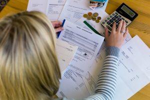 bigstock a woman with unpaid bills has 51927352
